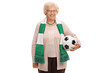 Happy elderly soccer fan with a scarf and a football