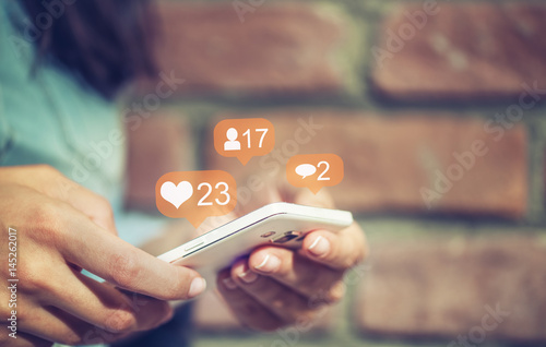 Young  girl using smart phone,Social media concept.