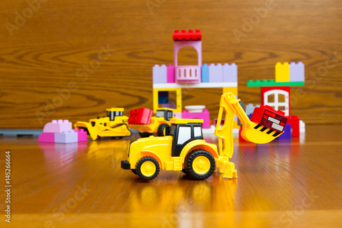 Toy tractor with bricks Poster