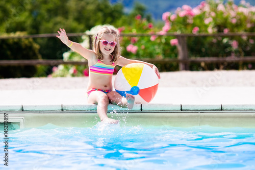 Child in swimming pool on summer vacation Poster