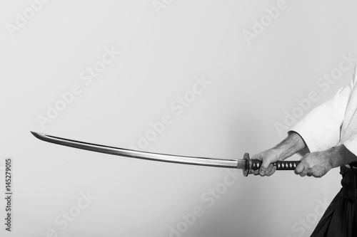 Hands holding the Katana on white background. Poster