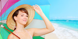 Young attractive woman in straw hat use sun protective umbrella on the beach. Greeting from summer holidays. People and leisure activities. - 145281210