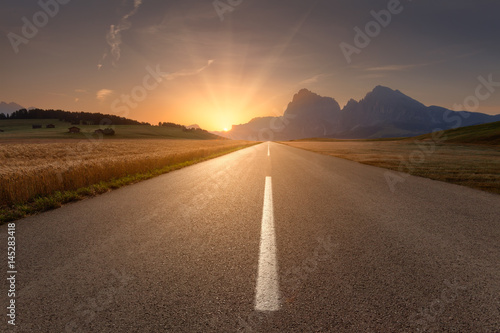 Poster Beautiful scenery with road towards the setting sun