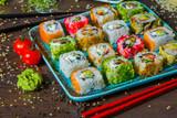 Various kind of sushi food served on black background. Best Types of Sushi Rolls