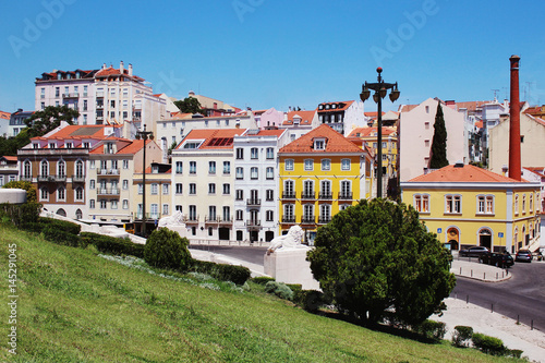 Lisbon architecture. Colorful houses against the blue sky Poster