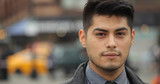 Young Hispanic Latino man in city face portrait - 145308027