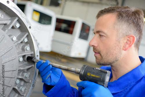 Mechanic using air powered tool