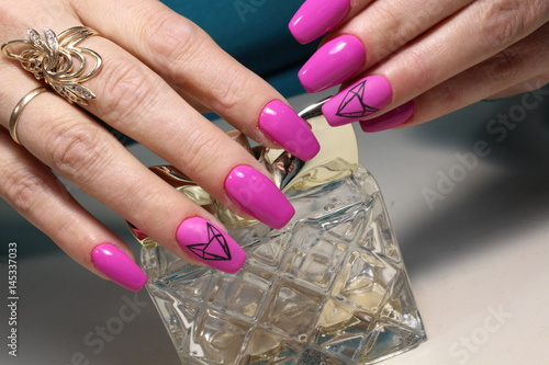 Pink manicure with perfume
