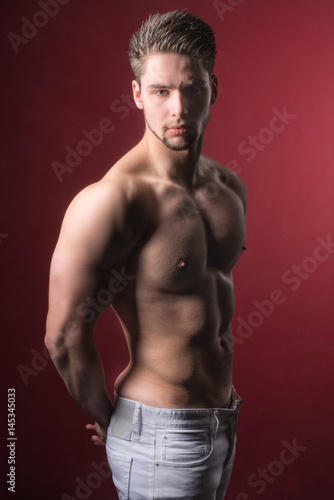 Sportive, attractive, good looking man or boy posing for the camera in studio Poster