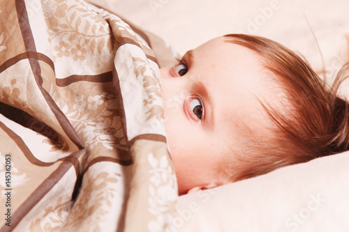 bedtime, young girl lying on the bed under the covers Poster