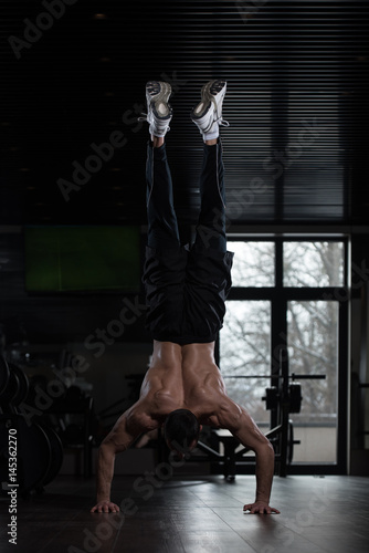 Athlete Doing Extreme Push Ups On Floor Handstand