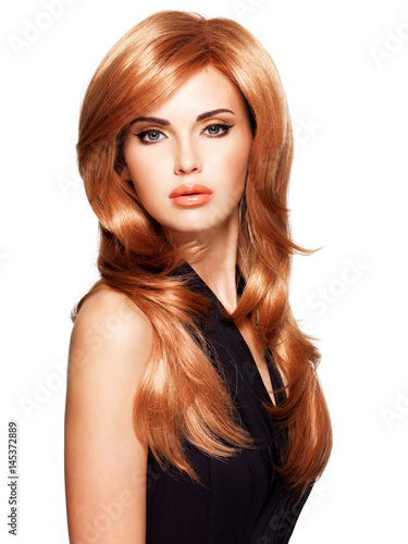 Poster Beautiful woman with long straight red hair in a black dress.