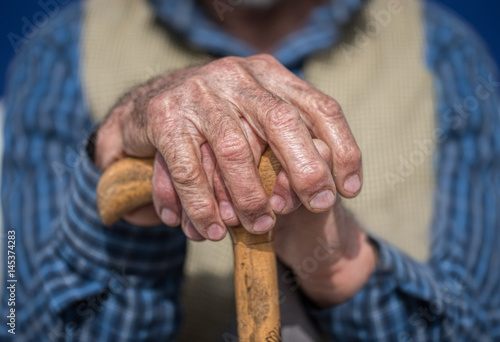 Old Man Hands with cane Poster