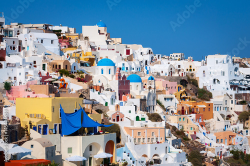 Foto op Canvas Traditional white architecture with blue churches on Santorini island, Greece