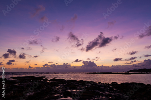 Beautiful rock patterns and sunrise at shore Poster