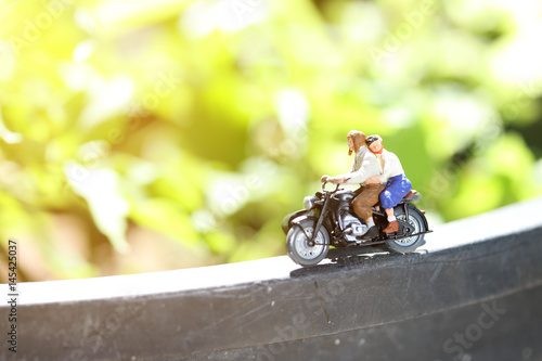 Miniature people bride and groom couple with motorcycle Poster
