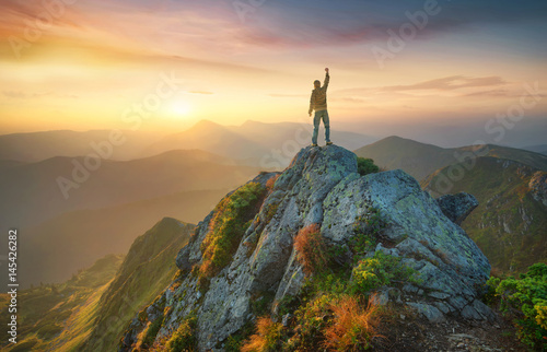 Papiers peints Morning Glory Tourist on the peak of high rocks. Sport and active life concept