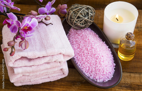 Poster Spa still life with orchid flowers, towels,salt, scent candle and oil bottle