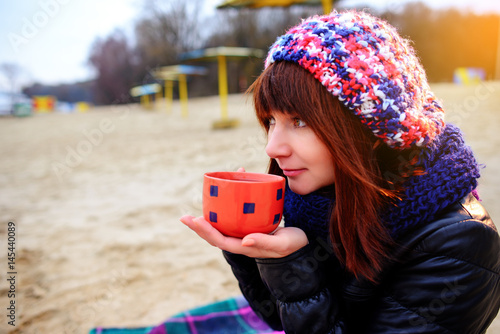 Beautiful woman drinking coffee from cup Poster