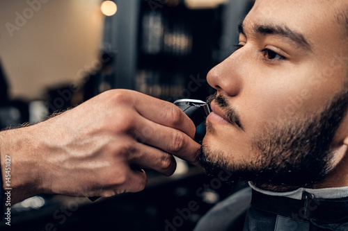 Close up image of men's beard grooming.