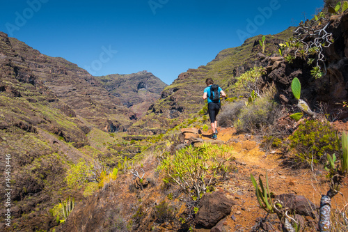 Papiers peints Iles Canaries Hiker on a trail in the Canary Islands, Spain