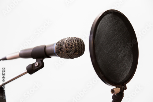 Cardioid condenser microphone and pop filter on a gray background Poster