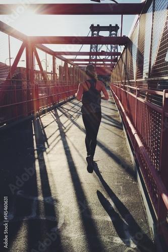 Zdjęcia na płótnie, fototapety, obrazy : Young woman morning jogging
