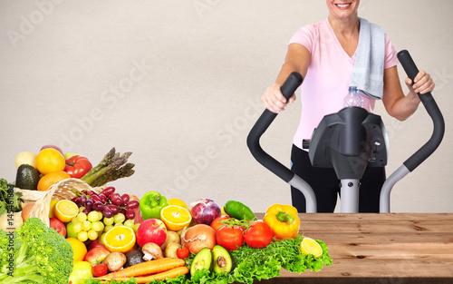 Woman with elliptical trainer © Kurhan
