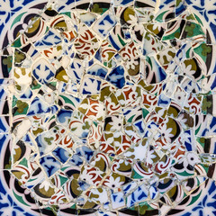 Mosaic tile in Barcelona, decoration broken glass, Park Guell, Spain. Designed by Gaudi