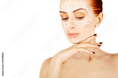 Poster young red haired woman closeup with surgery lines, white  background