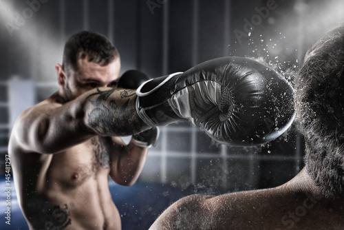 Poster Boxer in a boxe competition beats his opponent