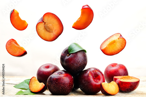 plums with flying slices