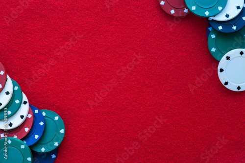 Poster Red felt table with poker chips over it and copy space