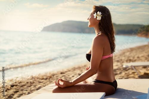 Girl Meditating On The Beach Poster