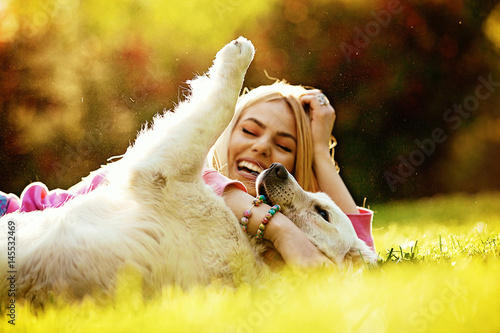 Poster Woman enjoying park with dog