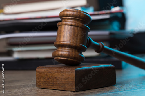 Poster Wooden table with hammer, documents