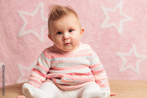 Poster smiling little baby girl sitting