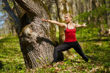 Young woman doing yoga in a forest