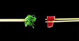 Fototapeta Maki - Composition of sushi, sashimi, uramaki and nighiri. typical Japanese dish consisting of rice, salmon or tuna,shrimp and fish eggs soaked in soy. Concept: Japanese restaurant, sushi, oriental tradition © HQUALITY