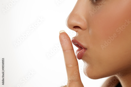 Juliste Close up finger in front of lips ... concept of silence