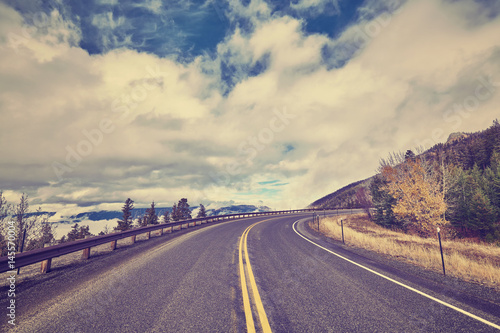 Papiers peints Aubergine Vintage stylized scenic mountain road, USA.