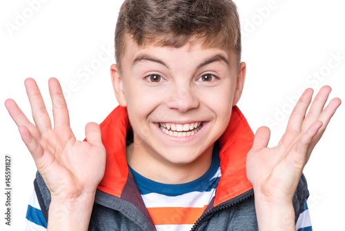 Emotional portrait of caucasian laughing happy teen boy Poster