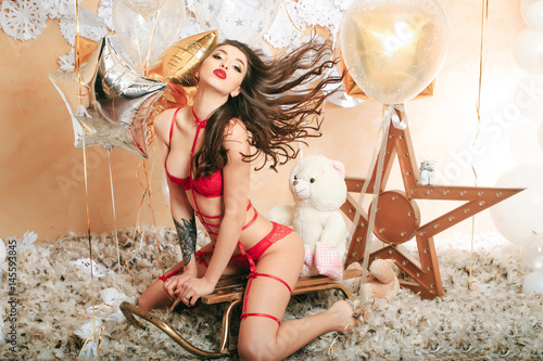 sexy woman in red lingerie on sledge in red lingerie Poster