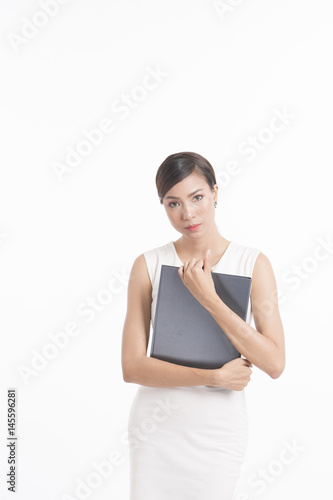 Business woman standing, holding file and waring white dress Poster