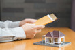 Businessman holding home loan application