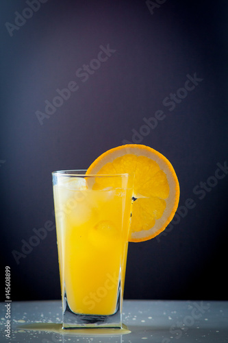 Orange juice and slices of orange fruit - 145608899