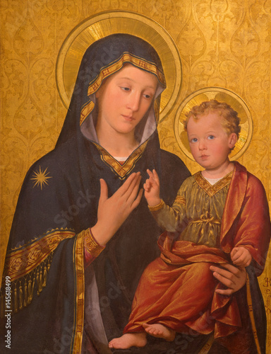 TURIN, ITALY - MARCH 13, 2017: The painting of Madonna with the Child in church Chiesa di San Giuseppe by Enrico Reffo (1909). © Renáta Sedmáková
