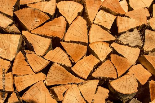 Foto op Canvas Brandhout textuur Holzstapel mit gehacktem Buchenholz