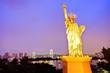Statue of Liberty and Rainbow Bridge at Tokyo Bay at night