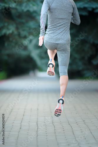 Juliste Runner athlete running on road
